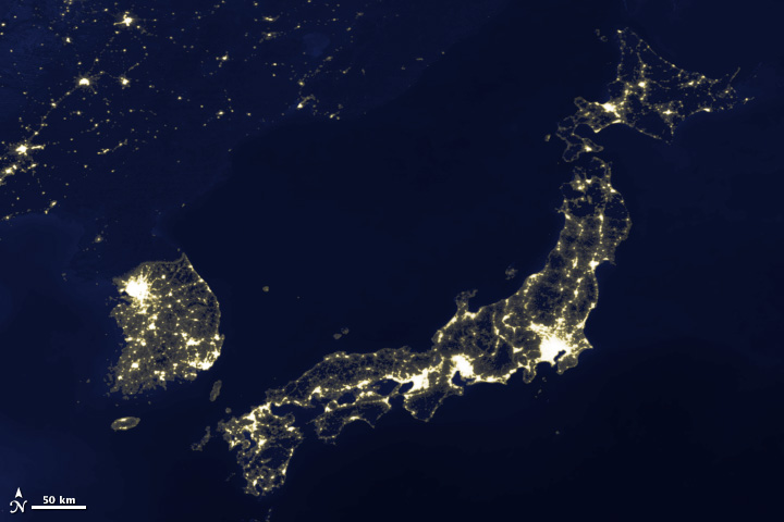 Image of Japan and Korea's city lights, 2003.